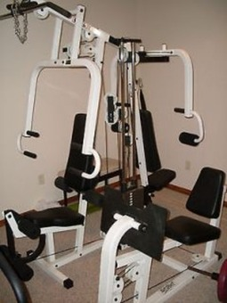 Tuff Stuff Muscle III machine with leg extension.
